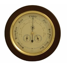 Brass barometer, thermometer & hygrometer on cherry weather station